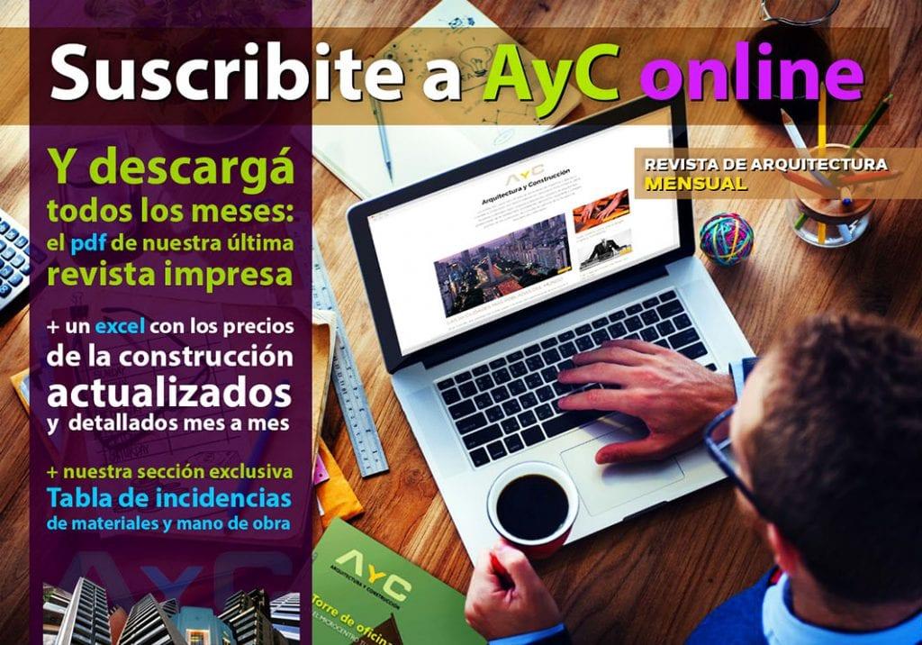 hombre suscribiendose a AyC online con su lapto, tomando cafe y con varias revistas sobre la mesa